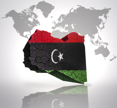 Map of Libya with Libyan Flag on a world map background photo