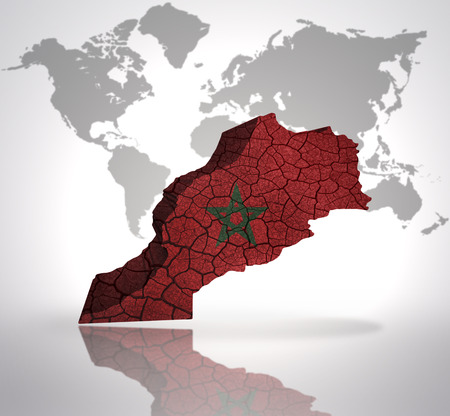 Map of Morocco with Moroccan Flag on a world map background photo
