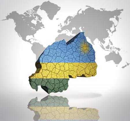 kigali: Map of rwanda with rwandan Flag on a world map background