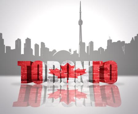 Word Toronto with national flag of Canada near skyline silhouette photo