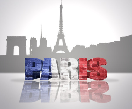 Word Paris with national flag of france near skyline silhouette photo