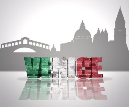 Word Venice with national flag of italy near skyline silhouette photo