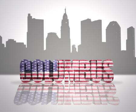 Word Columbus with National Flag of USA near skyline silhouette photo