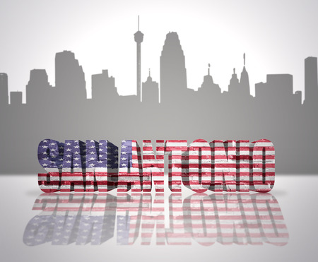 Word San Antonio with National Flag of USA near skyline silhouette Stock Photo
