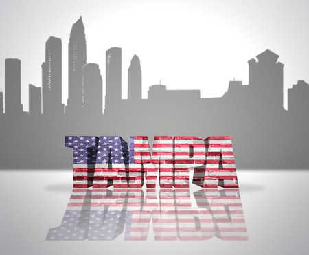 Word Tampa with National Flag of USA near skyline silhouette photo
