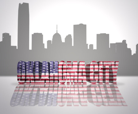 Word Oklahoma City with National Flag of USA near skyline silhouette photo