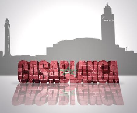 Word Casablanca with national flag of Morocco near skyline silhouette photo