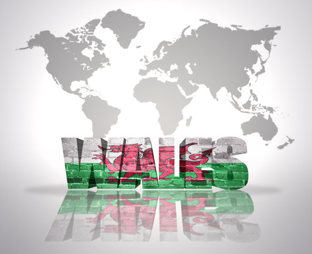 welsh flag: Word Wales with Welsh Flag on a world map background