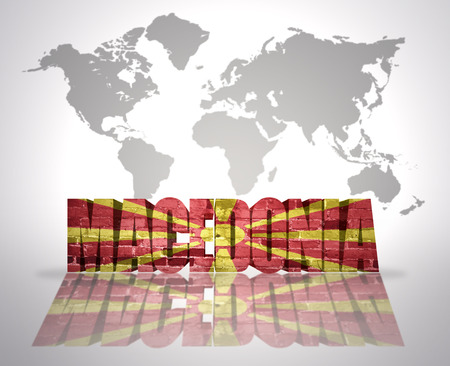 macedonian flag: Word Macedonia with Macedonian Flag on a world map background Stock Photo