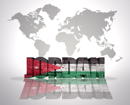 Word Jordan with Jordan Flag on a world map background photo