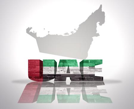 mideast: Word United Arab Emirates with National Flag near map of United Arab Emirates Stock Photo