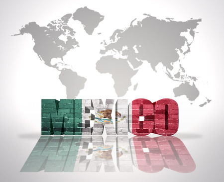 Word Mexico with Mexican Flag on a world map background photo