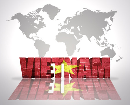 Word Vietnam with Vietnamese Flag on a world map background photo