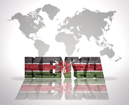 Word Kenya with Kenyan Flag on a world map background photo