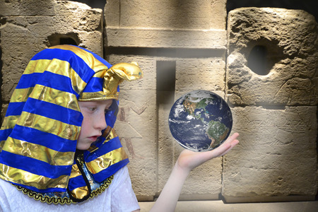 Egyptian boy holds Earth globe in his hand photo