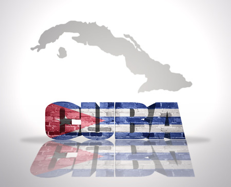 Word Cuba with National Flag near map of Cuba photo
