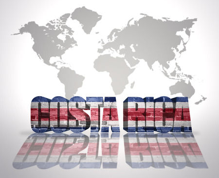 rican: Word Costa Rica with Costa Rican Flag on a world map background Stock Photo