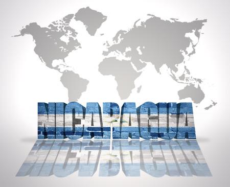 nicaraguan: Word Nicaragua with Nicaraguan Flag on a world map background