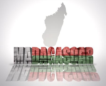 madagascar: Word Madagascar with National Flag near map of Madagascar