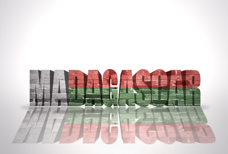 Word Madagascar with National Flag on the white background photo