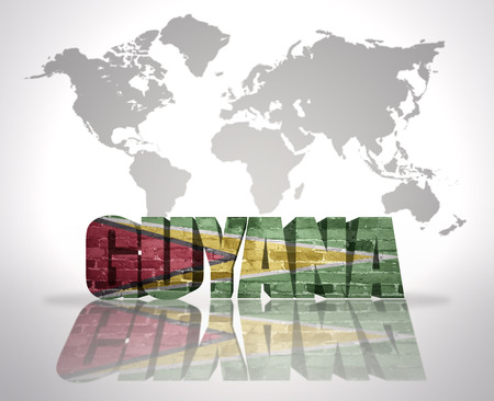 guyanese: Word Guyana with Guyanese Flag on a world map background