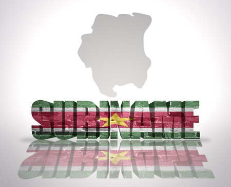 suriname: Word Suriname with National Flag near map of Suriname