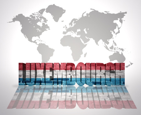 Word Luxembourg with Luxembourg Flag on a world map background photo