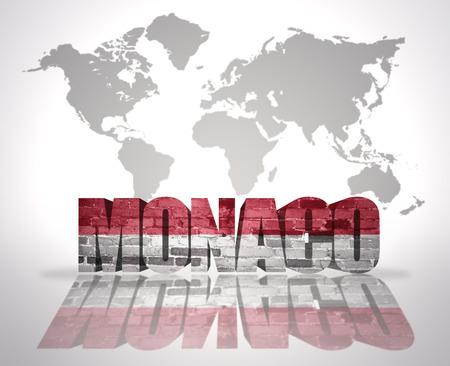 Word Monaco with Monaco Flag on a world map background photo