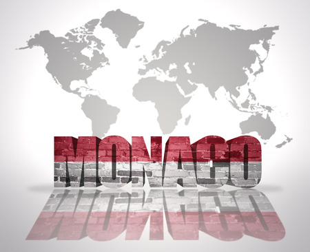 Word Monaco with Monaco Flag on a world map background photo