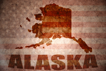 alaska map: alaska map on a vintage american flag background Stock Photo