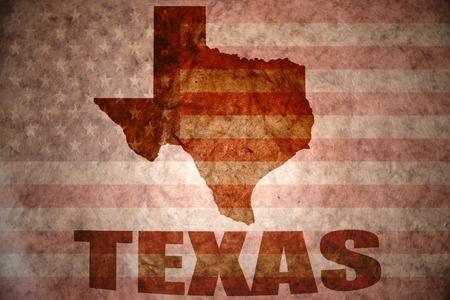 Texas kaart op een vintage Amerikaanse vlag achtergrond