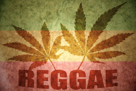 text reggae with cannabis leafs on a vintage background photo