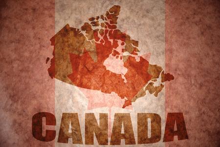 Canada kaart op een vintage Canadese vlag achtergrond