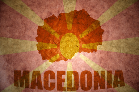 macedonian flag: macedonia map on a vintage macedonian flag background