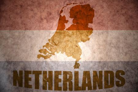 netherlands map: netherlands map on a vintage dutch flag background
