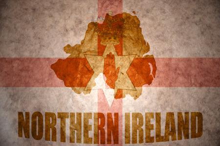 northern ireland map on a vintage northern ireland flag background photo
