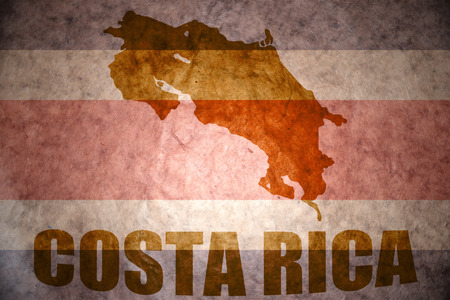 costa rican: costa rica map on a vintage costa rican flag background