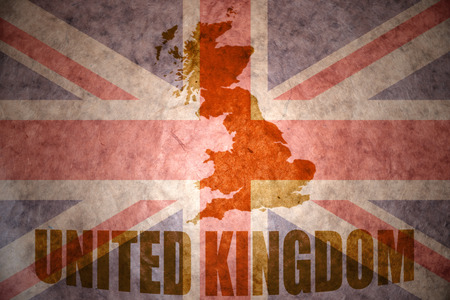 united kingdom map on a vintage british flag background photo