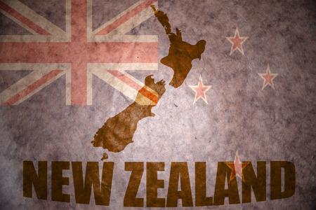 new zealand map on a vintage new zealand flag background Stock Photo