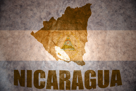 nicaraguan: nicaragua map on a vintage nicaraguan flag background