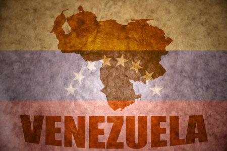 venezuela map on a vintage venezuelan flag background