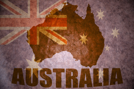 australia map on a vintage australian flag background photo