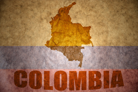 colombian flag: colombia map on a vintage colombian flag background