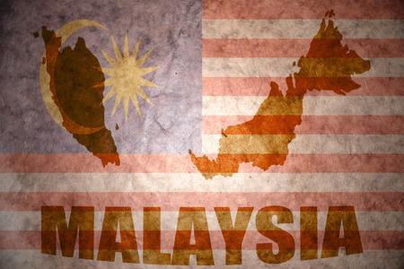 malaysia map on a vintage malaysian flag background photo