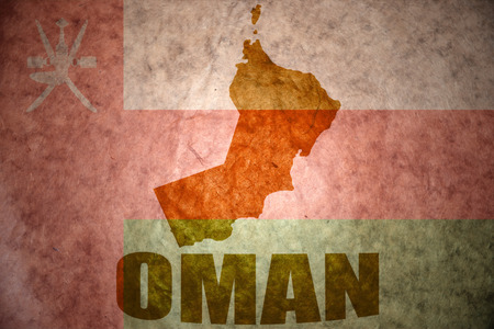 oman background: oman map on a vintage omani flag background Stock Photo