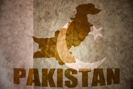 pakistani pakistan: pakistan map on a vintage pakistani flag background