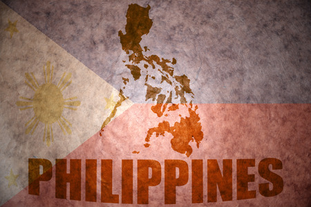 Filippijnen kaart op een vintage Filippijnse vlag achtergrond Stockfoto