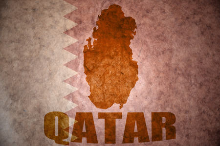 ancient near east: qatar map on a vintage qatar flag background
