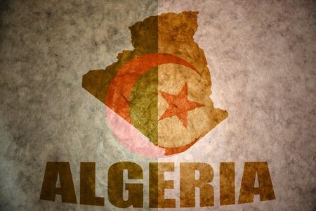 algerian flag: algeria map on a vintage algerian flag background