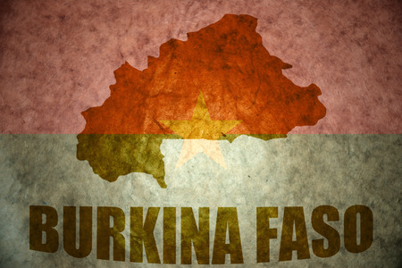 burkina faso: burkina faso map on a vintage burkina faso flag background